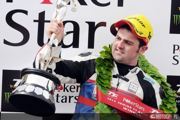 PACEMAKER BELFAST 06/06/14: Michael Dunlop (Hawk Racing BMW) celebrates on the podium after winning the Pokerstars Senior race at the 2014 Isle of Man TT